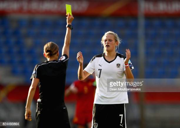 Referee Stephanie Frappart shows Carina Wenninger of Austria a yellow card during the UEFA Women's Euro 2017 Quarter Final match between Austria and...