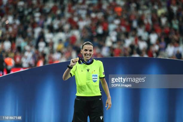 Referee Stephanie Frappart shows her medal after leading the 2019 UEFA Super Cup final at Vodafone Park