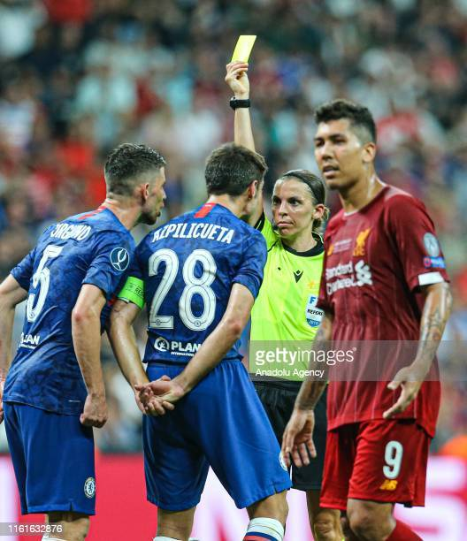 Referee Stephanie Frappart shows yellow card to Chelsea's Cesar Azpilicueta during the UEFA Super Cup final between Liverpool and Chelsea at Vodafone...