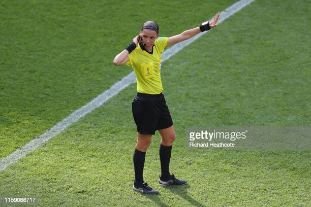 Referee Stephanie Frappart signals during the 2019 FIFA Women's World Cup France Quarter Final match between Germany and Sweden at Roazhon Park on...