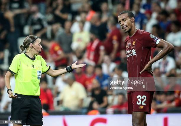 Referee Stephanie Frappart speaks with Joel Matip of Liverpool during the UEFA Super Cup match between Liverpool and Chelsea at Vodafone Park in...