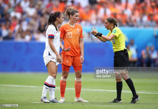 Referee Stephanie Frappart talks to Alex Morgan of USA and Dominique Bloodworth of the Netherlands during the 2019 FIFA Women's World Cup France...