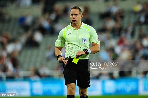 Referee Stephen Martin pulls out his yellow card during the EFL cup between Newcastle United and Cheltenham Town at StJames' Park on August 23 in...