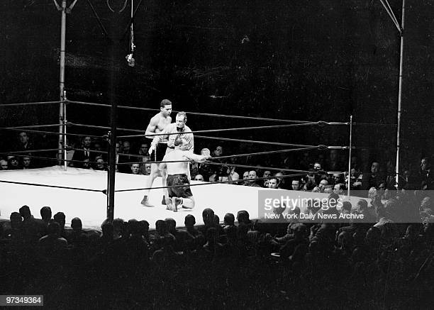 Referee steps between Joe Louis and Tony Galento Louis defeated Galento to retain his World Heavyweight Title with KO in 4th round
