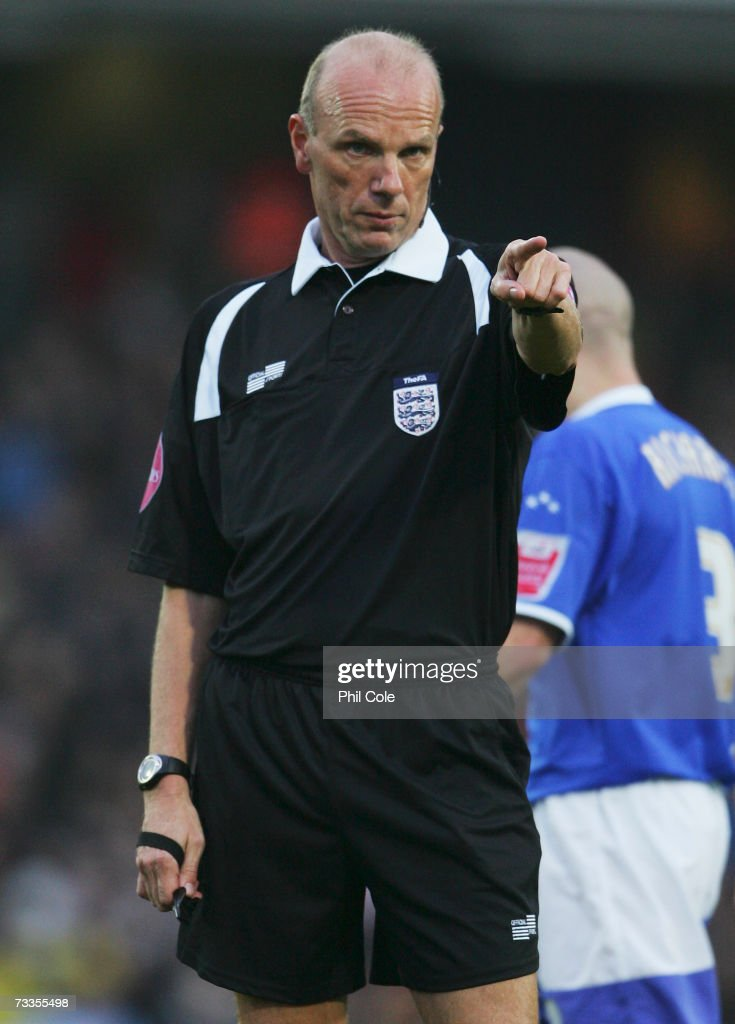 Referee Steve Bennett gestures during the FA Cup sponsored by E.ON 5th Round match between Watford and Ipswich Town at Vicarage Road on February 17, 2007 in Watford, England.