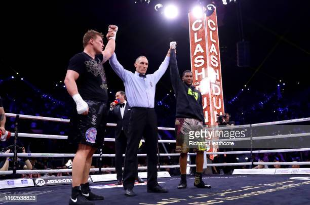 Referee Steve Gray raises Alexander Povetkin and Michael Hunter hands as they draw in the of the WBC World Heavyweight Eliminator fight between...