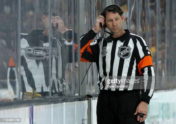 Referee Steve Kozari officiates Game Five of the 2019 NHL Stanley Cup Final between the Boston Bruins and the St Louis Blues at TD Garden on June 06...