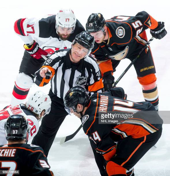 Referee Steve Kozari talks with Blake Coleman of the New Jersey Devils and Adam Henrique of the Anaheim Ducks during the second period of the game at...