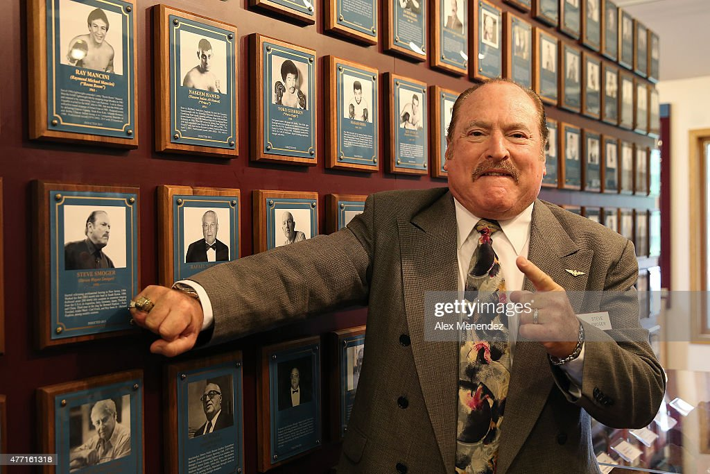 Referee Steve Smoger poses with his new ring and photo after the induction ceremony at the International Boxing Hall of Fame induction Weekend of Champions events on June 14, 2015 in Canastota, New York.