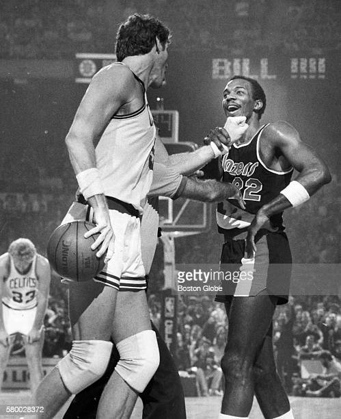 A referee stops Boston Celtics player Bill Walton front left from punching Portland Trail Blazers player Clyde Drexler right during a game at the...