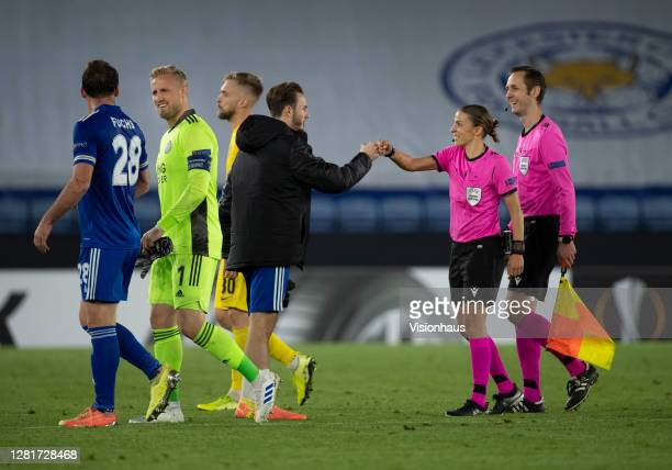 Referee Stéphanie Frappart fist pumps with James Maddison of Leicester City during the UEFA Europa League Group G stage match between Leicester City...