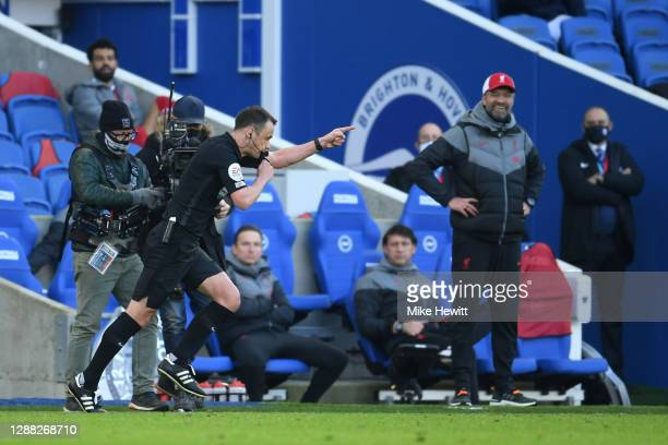 Referee Stuart Attwell awards Brighton and Hove Albion a penalty following a VAR review during the Premier League match between Brighton & Hove...