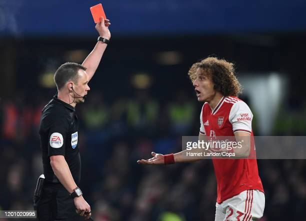 Referee Stuart Attwell Awards David Luiz of Arsenal a red card during the Premier League match between Chelsea FC and Arsenal FC at Stamford Bridge...