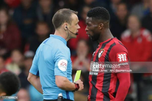 Referee Stuart Attwell books Jefferson Lerma of Bournemouth during the Premier League match between AFC Bournemouth and West Ham United at Vitality...