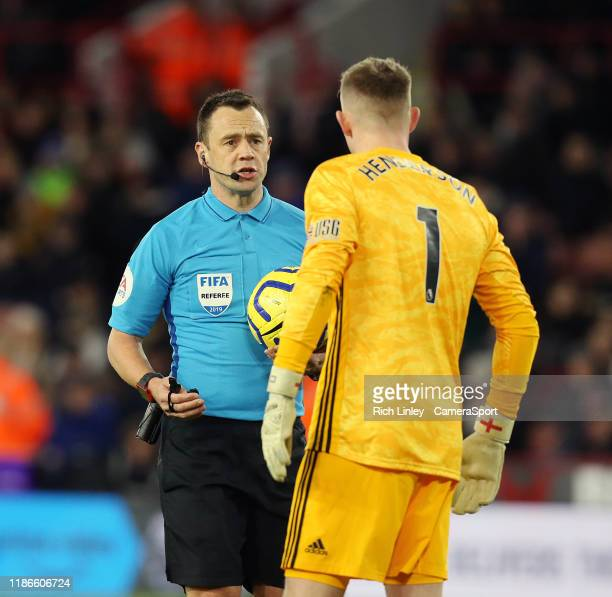 SHEFFIELD ENGLAND DECEMBER Referee Stuart Attwell has words with Sheffield United's Dean Henderson during the Premier League match between Sheffield...