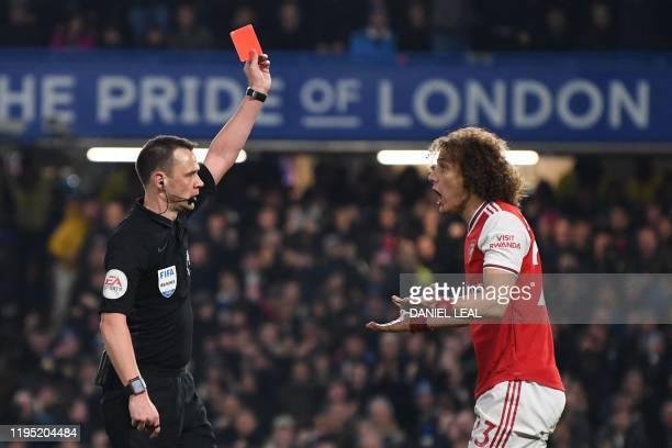 Referee Stuart Atwell shows a red card to Arsenal's Brazilian defender David Luiz to send him off for fouling Chelsea's English striker Tammy Abraham...