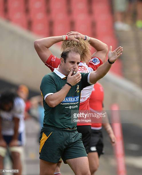 Referee Stuart Berry blows the final whistle during the Super Rugby match between Lions and Blues at Ellis Park on March 15 2014 in Johannesburg...
