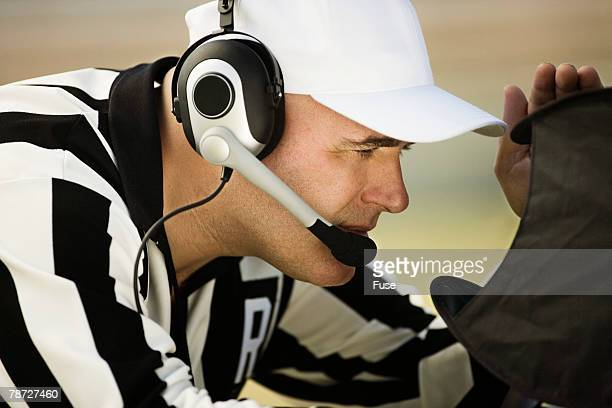 referee studying instant replay - american football referee stock pictures, royalty-free photos & images