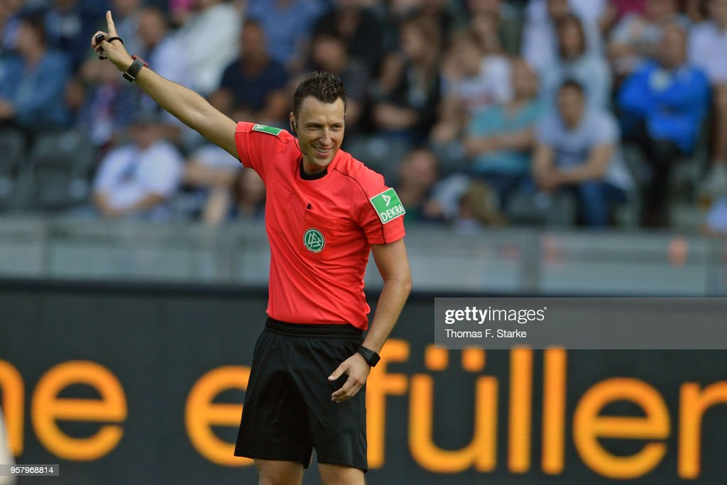 Referee Sven Jablonski reacts during the Bundesliga match between Hertha BSC and RB Leipzig at Olympiastadion on May 12, 2018 in Berlin, Germany.