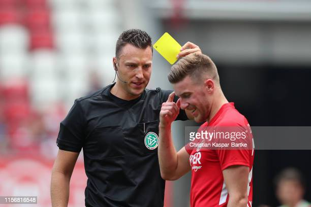 Referee Sven Jablonski shows Christian Kuehlwetter of 1FC Kaiserslautern the yellow card during the 3 Liga match between 1 FC Kaiserslautern and...