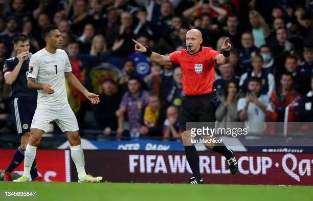 Referee Szymon Marciniak awards Scotland's second goal after a VAR review during the 2022 FIFA World Cup Qualifier match between Scotland and Israel...