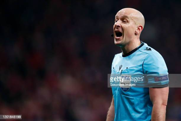 Referee Szymon Marciniak during the UEFA Champions League match between Atletico Madrid v Liverpool at the Estadio Wanda Metropolitano on February...