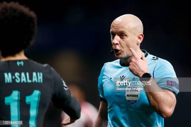 Referee Szymon Marciniak during the UEFA Champions League match between Atletico Madrid v Liverpool at the Estadio Wanda Metropolitano on February...