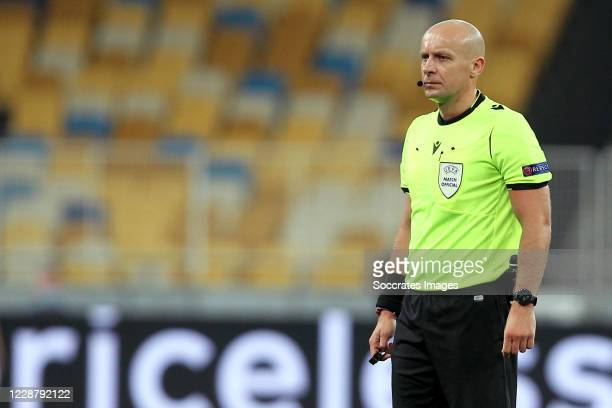 Referee Szymon Marciniak during the UEFA Champions League match between Dinamo Kiev v Gent at the Central Dynamo Stadium on September 29, 2020 in...