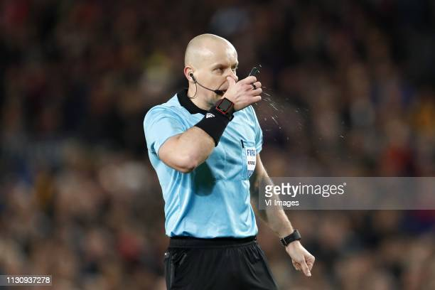 Referee Szymon Marciniak during the UEFA Champions League round of 16 match between FC Barcelona and Olympique Lyonnais at Camp Nou on March 13, 2019...