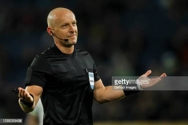 Referee Szymon Marciniak gestures during the international friendly match between Ukraine and Northern Ireland at Dnipro-Arena on June 3, 2021 in...