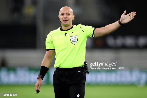 Referee Szymon Marciniak gestures during the UEFA Europa League Semi Final between Internazionale and Shakhtar Donetsk at Merkur Spiel-Arena on...