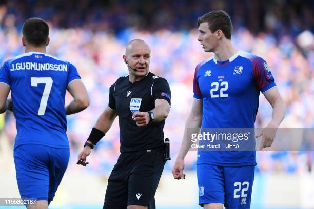 Referee Szymon Marciniak in action during the UEFA Euro 2020 Qualifier match between Iceland and Turkey at Laugardalsvollur National Stadium on June...