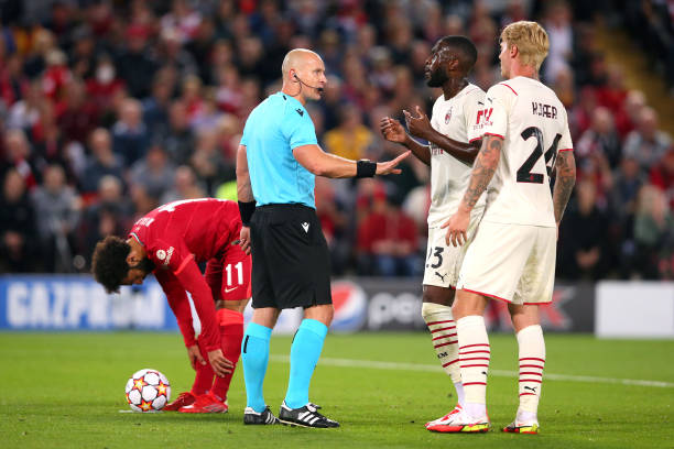 Referee Szymon Marciniak interacts with Fikayo Tomori of AC Milan during the UEFA Champions League group B match between Liverpool FC and AC Milan at...