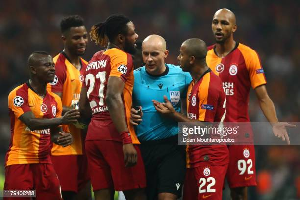 Referee, Szymon Marciniak is surrounded by the Galatasaray players during the UEFA Champions League group A match between Galatasaray and Paris...