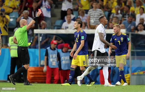 Referee Szymon Marciniak red Card for Jerome Boateng of Germany during the 2018 FIFA World Cup Russia group F match between Germany and Sweden at...