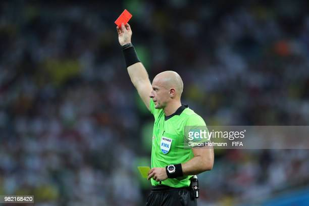 referee Szymon Marciniak shows a red card to Jerome Boateng during the 2018 FIFA World Cup Russia group F match between Germany and Sweden at Fisht...