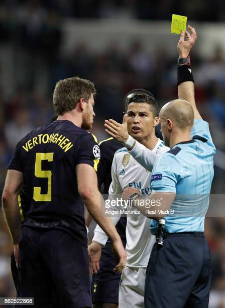 Referee Szymon Marciniak shows the yellow card to Cristiano Ronaldo of Real Madrid during the UEFA Champions League group H match between Real Madrid...