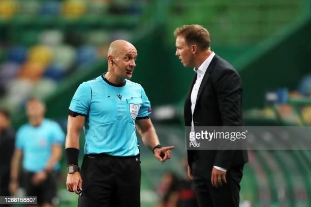 Referee Szymon Marciniak speaks with Julian Nagelsmann, Head Coach of RB Leipzig during the UEFA Champions League Quarter Final match between RB...