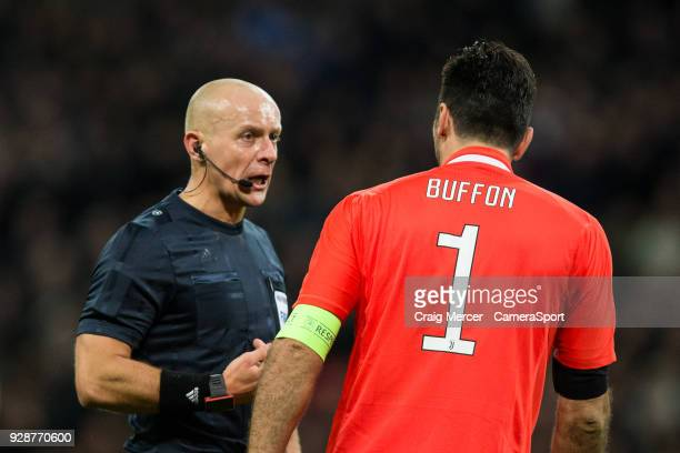 Referee Szymon Marciniak talks to Gianluigi Buffon of Juventus during the UEFA Champions League Round of 16 Second Leg match between Tottenham...