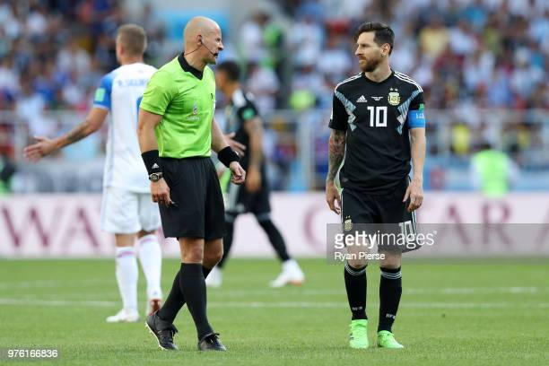 Referee Szymon Marciniak talks to Lionel Messi of Argentina during the 2018 FIFA World Cup Russia group D match between Argentina and Iceland at...