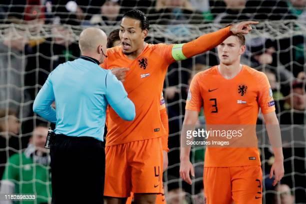 Referee Szymon Marciniak, Virgil van Dijk of Holland during the EURO Qualifier match between Northern Ireland v Holland at the Windsor Park on...