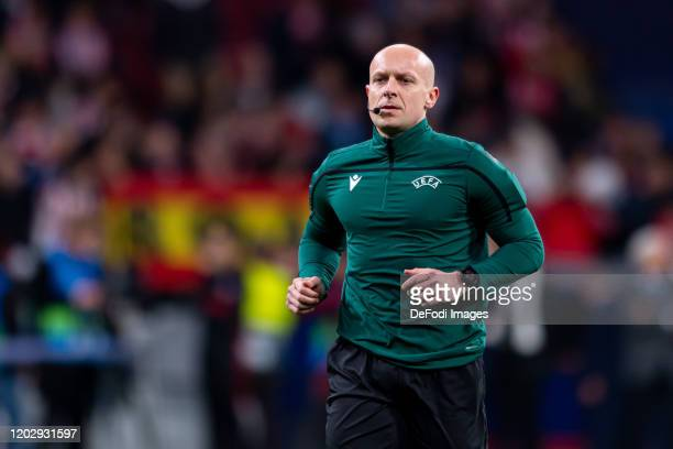 Referee Szymon Marciniak warms up prior to the UEFA Champions League round of 16 first leg match between Atletico Madrid and Liverpool FC at Wanda...