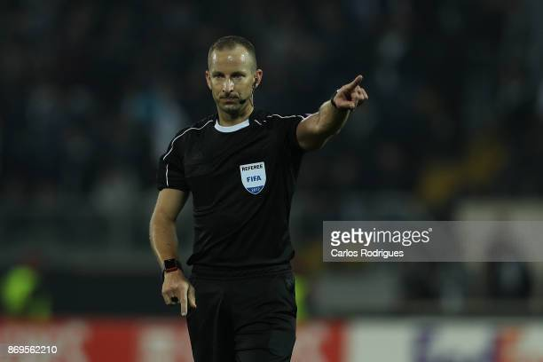 Referee Tamas Bognar from Hungary during the match between Vitoria Guimaraes and Olympique Marseille match for UEFA Europa League at Estadio da Dom...