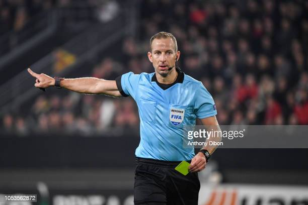 Referee Tamas Bognar gives a yellow card during the UEFA Europa League match between Stade Rennais and Dynamo Kiev on October 25 2018 in Rennes France