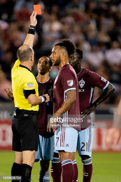 Referee Ted Unkel issues a red card to Bismark AdjeiBoateng of the Colorado Rapids right against Real Salt Lake at Dick's Sporting Goods Park on...