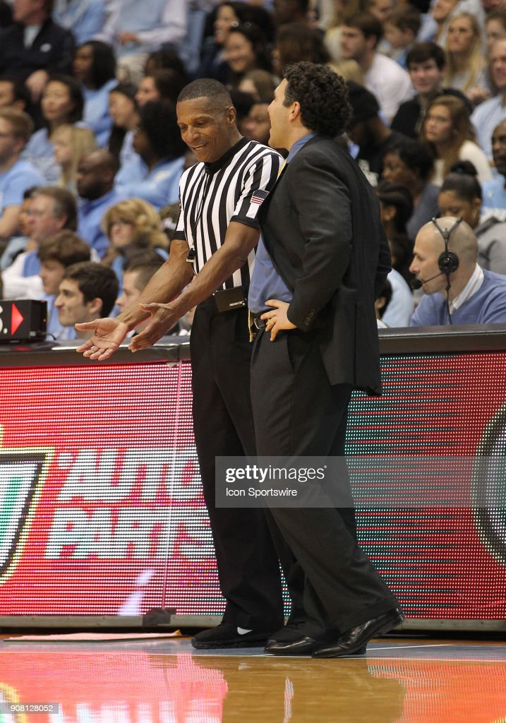 Referee Ted Valentine Has A Discussion With Georgia Tech Yellow Jackets  Head Coach Josh Pastner.