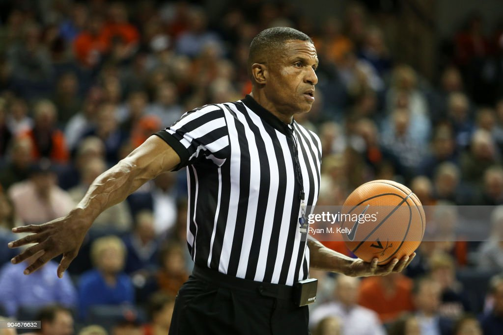 Referee Ted Valentine Resets Play After A Foul Call In The First Half  During A Game