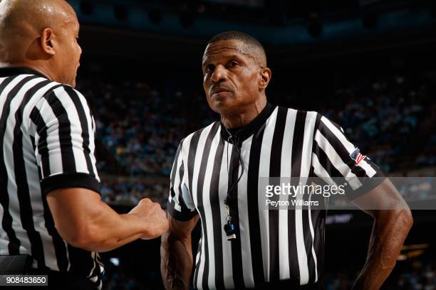 Referee Ted Valentine speaks to fellow referee Bill Covington Jr during a game between the North Carolina Tar Heels and the Georgia Tech Yellow...