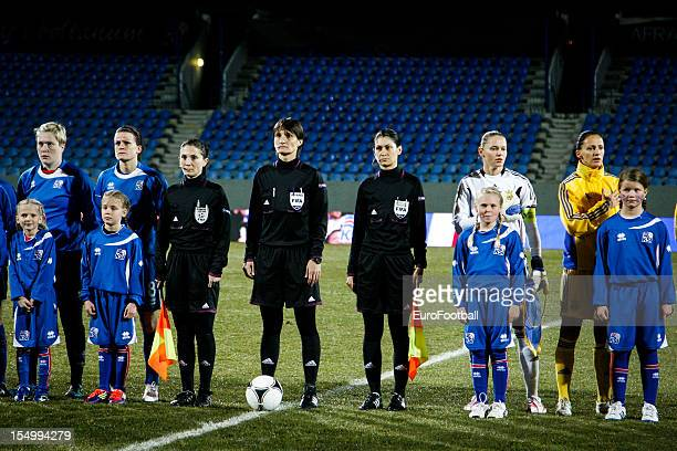 Referee Teodora Albon lines up alongside the Iceland and Ukraine players prior to the UEFA Women's EURO 2013 playoff second leg match between Iceland...