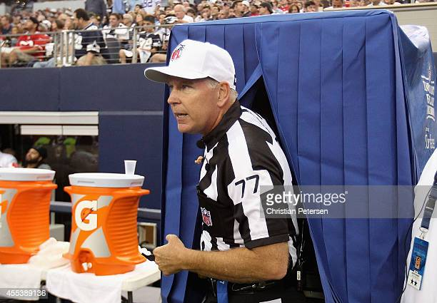 Referee Terry McAulay leaves the instant replay booth during the NFL game between the San Francisco 49ers and the Dallas Cowboys at ATT Stadium on...